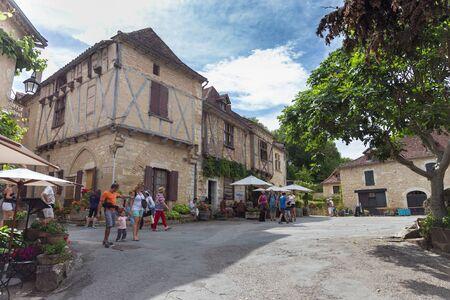 parc naturel: SAINT-CIRQ-LAPOPIE - JULY 20, 2014: Tourists visiting Saint-Cirq-Lapopie in France. The picturesque village is a member of the Les Plus Beaux Villages de France (The most beautiful villages of France) association. Editorial