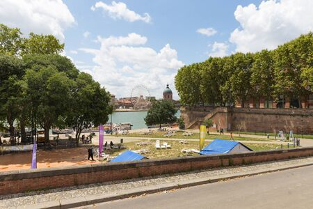 daurade: TOULOUSE, FRANCE - JULY 21, 2014: La Daurade is a district in Toulouse, France. Located in the city center, it is a popular place for walkers and tourists to enjoy a view over the Garonne river.