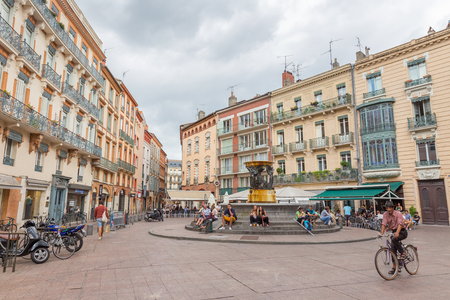 owes: TOULOUSE, FRANCE - JULY 21, 2014:  Place de la Trinite owes its name to the convent of the Trinity. In 1826 they installed a fountain, work of Urbain Vitry, taking water from the Toulouse water tower.