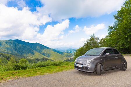 backroad: RIMONT, FRANCE - JULY 24, 2014: A Fiat 500 (Type 312) hatchback parked in the French Pyrenees.  The Fiat 500 is a city car built by Italian automaker Fiat since 2007.