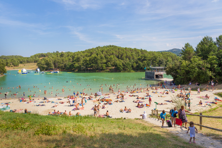 lac: CARCASSONNE, FRANCE - JULY 26, 2014: Lac de la Cavayere is a popular artificial freshwater lake with beaches in the Languedoc-Roussillon region of France, close to the mediaeval town of Carcassonne. Editorial