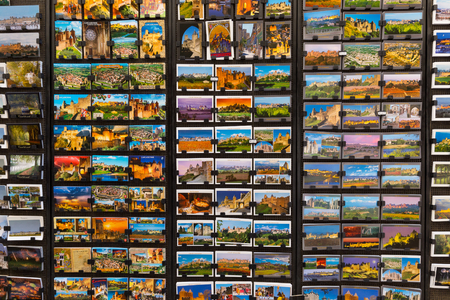 CARCASSONNE, FRANCE JULY 26, 2014: Postcards for sale in Carcassonne with images of the town and the historic citadel. On 6 March 2000 France issued a stamp commemorating the fortress of Carcassonne Editorial