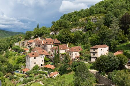 parc naturel: Village of Saint Circ Lapopie in France on a cloudy day Stock Photo