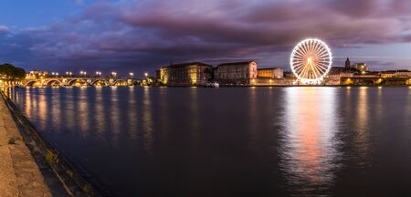 Nightly panorama of the Garonne river and Pont Neuf in Toulouse