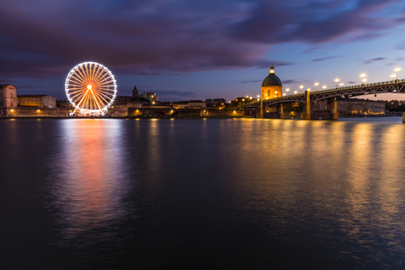 nightly: Nightly view of a spinning ferris wheel in Toulouse