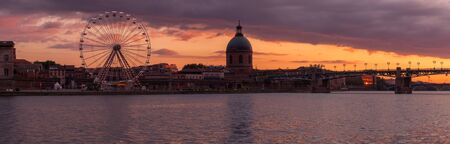 Panorama of Toulouse ferris wheel and Hopital de La Grave at sunset Stock Photo