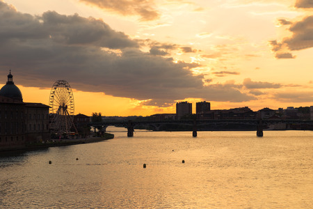 rive: Toulouse ferris wheel on the Garonne rive bank at sunset