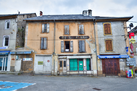 ww1: MASSAT, FRANCE - JULY 24, 2014: Characteristic buildings in the village of Massat, France. Because of strong rural migration Massat depopulated quickly, mainly due to WW1, to just 598 people in 1982. Editorial