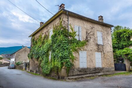 ww1: MASSAT, FRANCE - JULY 24, 2014: Characteristic houses in the village of Massat, France. Because of strong rural migration Massat depopulated quickly, mainly due to WW1, to just 598 people in 1982.
