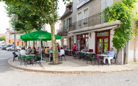 locals: LIMOGNE-EN-QUERCY, FRANCE  JULY 19, 2014: Locals and tourists enjoying refreshments and food in the local establishment in Limogne-en-Quercy, France. Editorial