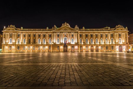 Captiole de Toulouse and Place du Capitole brightly lit at night Stock Photo