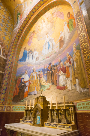 depicting: LOURDES, FRANCE - JULY 23, 2014: Detail of a side chapel mosaic depicting the Pentecost inside the Rosary Basilica in Lourdes