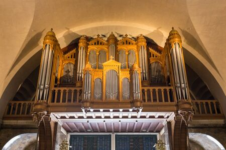 pipe organ: LOURDES, FRANCE - JULY 23, 2014: Interior view of the massive pipe organ inside the Rosary Basilica in Lourdes. Editorial