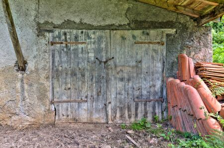 barn doors: Barn doors and a stack of roof tiles