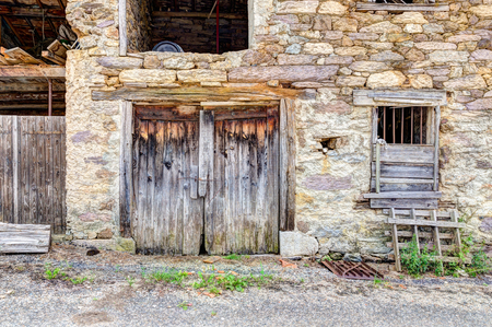Old beaten barn doors in the south of France Stock Photo