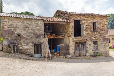 Old beaten cowshed in the south of France photo