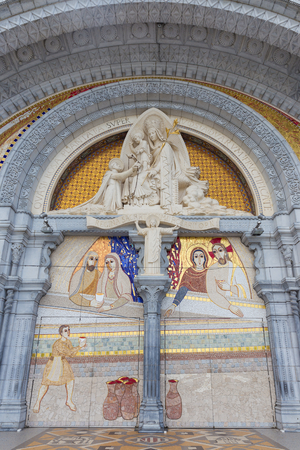 holy mary: Sculpture of the Holy Mary on the outside of the Rosary Basilica in Lourdes