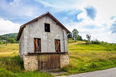 garret: Small barn on the side of the road in Espies in France Stock Photo