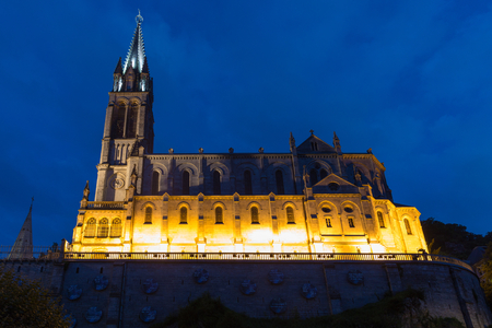 immaculate conception: The Basilica of Our Lady of the Immaculate Conception in Lourdes at night