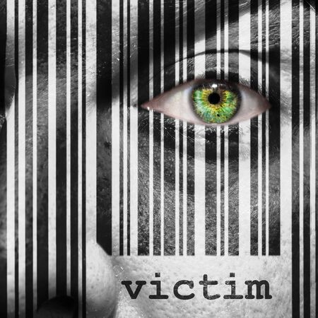 superimposed: Barcode with the word victim as concept superimposed on a mans face
