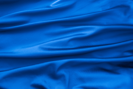 satin dress: Soft velvet piece of blue fabric with folds to be used as background