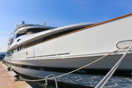 super yacht: CANNES, FRANCE - APRIL 12, 2015: Yacht anchored in Port Pierre Canto at the Boulevard de la Croisette in Cannes, France.  Cannes is synonymous with glamour thanks to its world-famous film festival.
