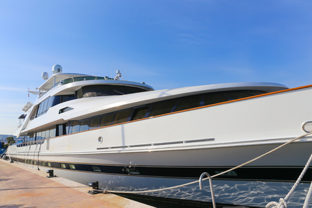mega: CANNES, FRANCE - APRIL 12, 2015: Yacht anchored in Port Pierre Canto at the Boulevard de la Croisette in Cannes, France.  Cannes is synonymous with glamour thanks to its world-famous film festival.