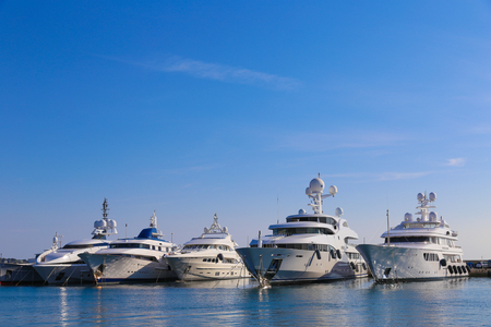 CANNES, FRANCE - APRIL 12, 2015: Yachts anchored in Port Pierre Canto at the Boulevard de la Croisette in Cannes, France.  Cannes is synonymous with glamour thanks to its world-famous film festival.