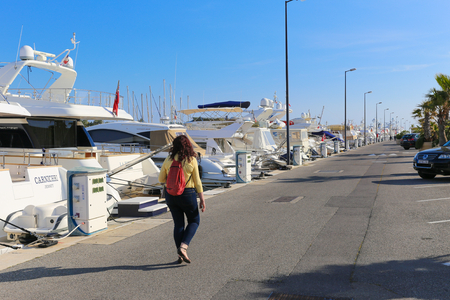 super yacht: CANNES, FRANCE - APRIL 12, 2015: Yachts anchored in Port Pierre Canto at the Boulevard de la Croisette in Cannes, France.  Cannes is synonymous with glamour thanks to its world-famous film festival.