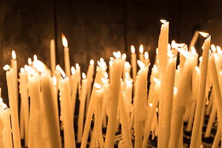 Many candles burning on display in Lourdes Stock Photo
