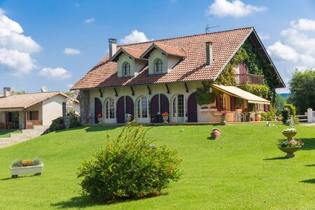 awnings windows: Big French country house with large green garden