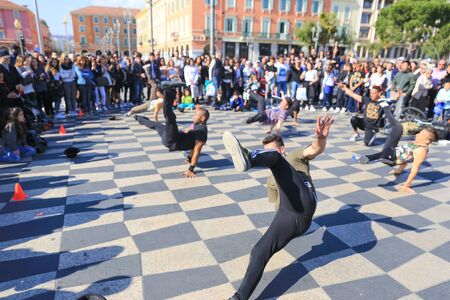 NICE, FRANCE APRIL 11, 2015: A group of street dancers performing a break dance routine on Place Massena in Nice, France.