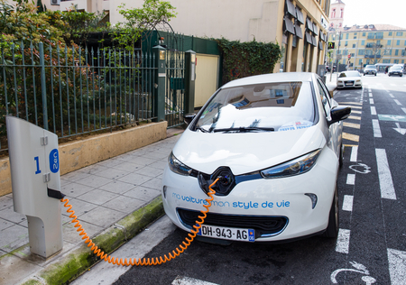 NICE, FRANCE APRIL 11, 2015: A Renault Zoe electric car is connected to an Auto Bleue charging station. Renault Zoe is a five-door supermini electric car produced by the French manufacturer Renault. Editorial