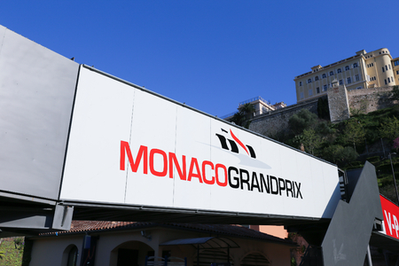 prix: MONACO - APRIL 13, 2015: Monaco Grand Prix logo on a pedestrian bridge. The Monaco Grand Prix is a Formula One motor race held on Circuit de Monaco, a narrow course laid out in the streets of Monaco.