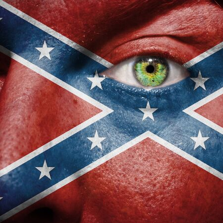 rebel flag: Confederate flag painted on a mans face. The flag is considered to be a rebel flag. The rectangular battle flag of the Army of Tennessee.