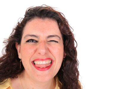 long tongue: Headshot of a Spanish woman winking and stikcing her tongue out with dark curly hair and brown eyes