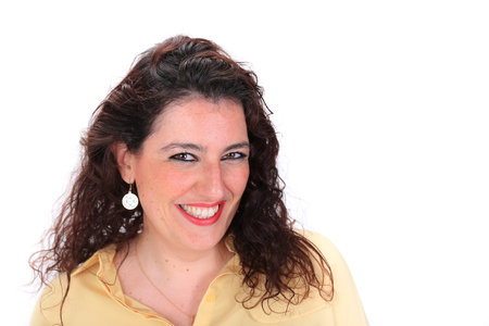 spanish woman: Face forward headshot of a happy smiling Spanish woman with dark hair brown eyes wearing a yellow blouse Stock Photo
