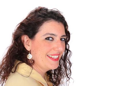 ojos marrones: Perfil lateral tiro en la cabeza de una mujer espa�ola con los ojos marrones pelo oscuro que llevaba una blusa de color amarillo
