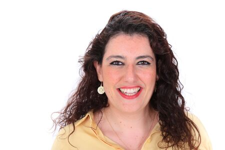 brown eyes: Face forward headshot of a Spanish woman with dark curly hair brown eyes wearing a yellow blouse
