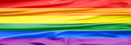 Soft Velvet Piece of Fabric banner in rainbow color to be used as background or overlay Stock Photo