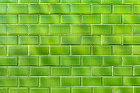 flashy: Green shiny flashy green modern retro wall with shaped bricks