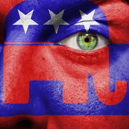 republican party: Republican party Elephant symbol painted on a mans face to show political support for the Republicans