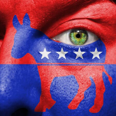 democratic donkey: Democratic party Donkey symbol painted on a mans face to show political support for the Democrats