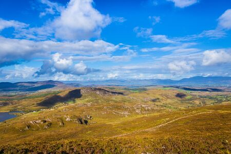 foothill: View of the mountains and valleys in Ballycullane from the foothill of Macgillycuddys Reeks mountain range in Kerry Ireland