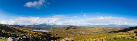 co kerry: Large panorama of Ballycullane and Lough Acoose in Kerry in Ireland on a sunny day with blue sky Stock Photo