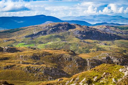 co  kerry: Undulating green and yellow rocky landscape in Kerry in Ireland