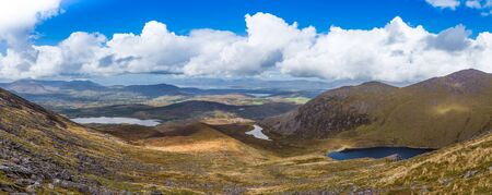 co  kerry: Panorama of valleys and mountains in County Kerry showing an undulating landscape on a sunny summer day in Ireland