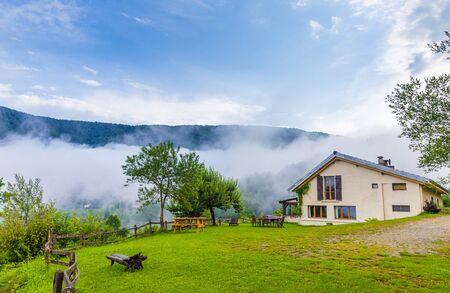 B&B Las Trinquades early morning in the Pyrenees in France with a view of low hanging clouds in the mountains Stock Photo
