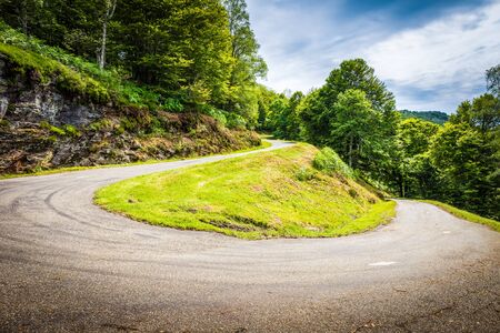 sharp curve: Winding road with sharp curve going up the mountain in the Pyrenees in France