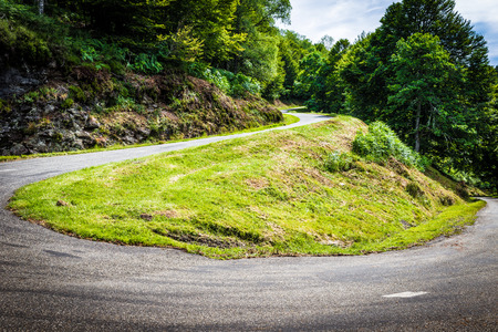 parc naturel: Winding road with sharp bend going up the mountain in the Pyrenees in France